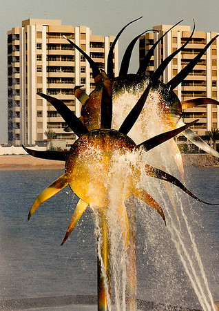 """The Finnish artist Elia Hiltunen (1922-2003) created """"The Sunflower Fountain"""", located in amongst some modest high-rise apartments along the Corniche Road. Its """"flowers"""" were made of a specially tinted variety of non-corrosive stainless steel. The fountain's spray nozzles were reported to be nonfunctional as late as 2010."""