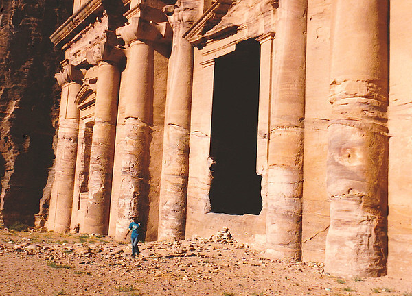 Close-up of the lower third of the façade of the Monastery, showing the effects of wind-blown sand that abraded the soft sandstone into which the structure was carved. My fellow geologist Walt Venum gives a good idea of the monumental scale of the building.