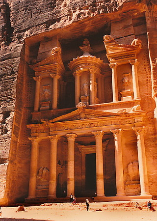 "Petra's most elaborate ruin, Al Khazneh (popularly known as ""the Treasury""), is hewn into the vividly-colored sandstone cliff. Note the Greek and Roman architectural influence in the colonnade of the façade. This structure served as a backdrop for the final scenes of ""Indian Jones and the Last Crusade."""