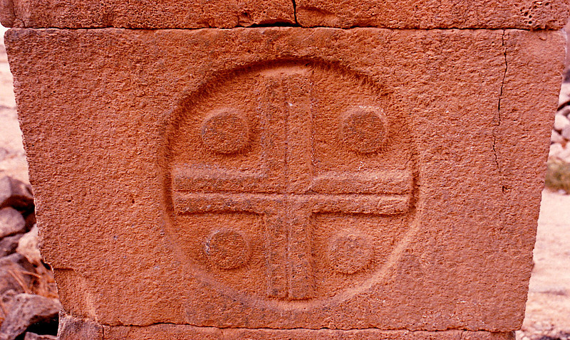 A Byzantine-style Christian cross inscribed on a masonry block supporting one of the arches of the South Church. Umm el Jimal, Jordan.