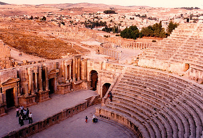 The South Theatre of Jerash. This theatre contains 32 tiers of seats, the lower rows of which are numbered in Greek, and could presumably be reserved. It could accommodate obout 4000 people. An inscription on the wall at the right ao the stage tells that a Statue of Victory which once stood there was presented by a non-commissioned officer of the army of Titus in A.D. 70, and cost 3000 drachmas.