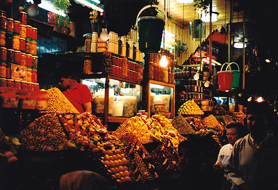 A night-time scene in the Olive Souq (open-air market) in Djemaa al Fna (Marrakech). As I am addicted to olives, I bought several liters of my favorite varieties of olives here.