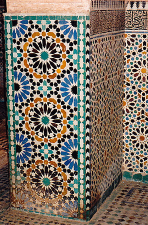 Intricately designed mosaic panels and ceramic tiles line the walls of a hammam (lavatory) in a madrasa in Rabat.