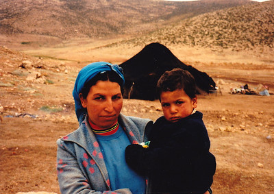 "While on the road to Marrakech, I stopped at an isolated nomadic camp, where I photographed this mother and her very uncooperative son (""No smile for you today"")."