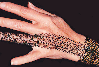 "A friend sporting a fresh henna ""tattoo"" poses for my camera. I saw many such fancy temporary tattoos on the hands of Muslim women in Morocco and the Middle Eastern countries I have visited."
