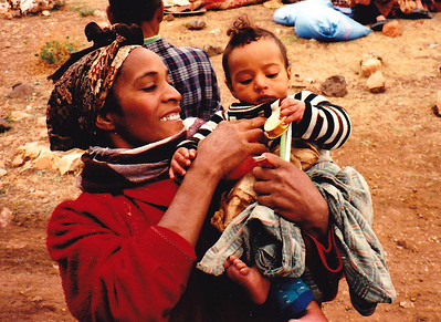 While on the road to Marrakech, I stopped at an isolated nomadic camp, where I photographed this happy mother and her very hungry infant who couldn't be bothered with the strange man with the camera.