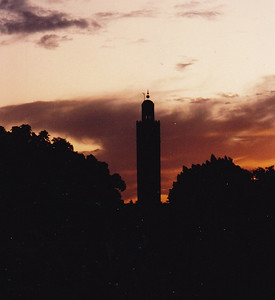 The Koutubiyya Mosque (Marrakech) backlit by the setting sun.