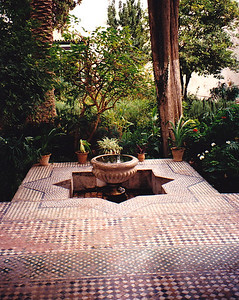 Seen in Marrakech: A secluded water fountain in the gardens of the Madrasa Bou Inania.