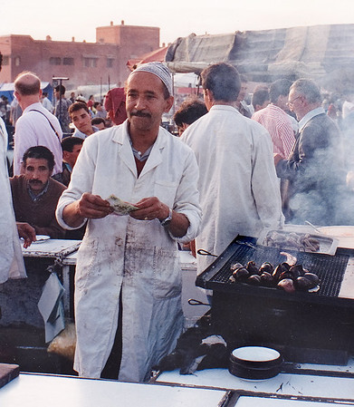 "A friendly hot-foods vendor in Jemaa Al Fna souq (open air-market), where I spent most of my time in the evenings I was in Marrakech. The Arabic name means ""Place of the Dead""; this is because of its previous role as an execution ground where the heads of criminals were displayed. In 1547 Calilph About Abbas Ahmed added stalls for an international marketplace that included Muslim and Christian vendors."