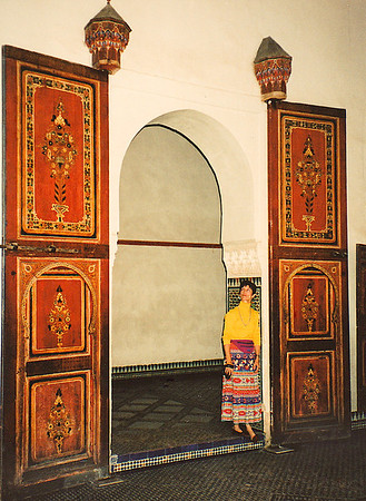 Immense wooden doors with intricate parquet inlay work adorns the inner sanctuary of a madras in Marrakech.