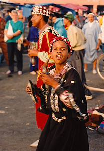Djemaa al Fna (Marrakech) minstrels: Young boy with hand cymbals.