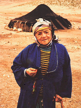 While on the road to Marrakech, I stopped at an isolated nomadic camp, where I photographed the matriarch of the family that lived in the camel's-wool tent in the background.
