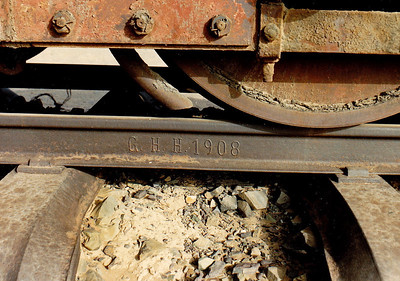 """A length of track displaying the date (""""1908"""") this stretch of track was laid."""