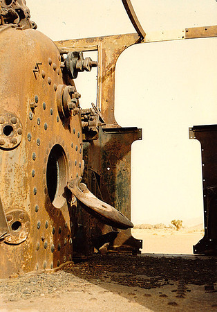 The blown-out boiler hatch of an engine left intact on tracks at a station site somewhere between Mada'in Salih and Al-Ula, Saudi Arabia.