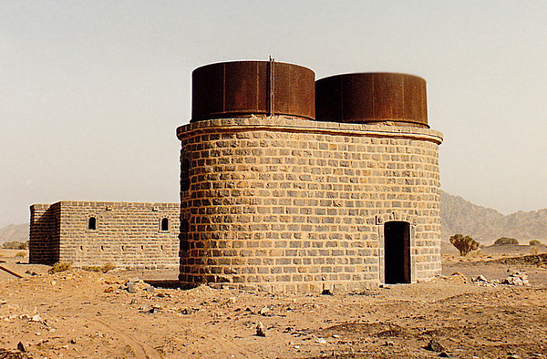 Blockhouse (background) and water tanks at the Abu Naam Station site.