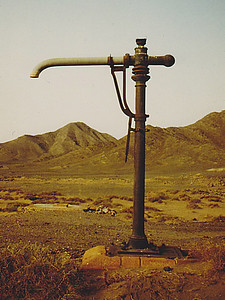 A crane-mounted water hose, Hidiyah Station site.