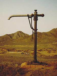 A crane-mounted water hose, Hidiyah Station site.