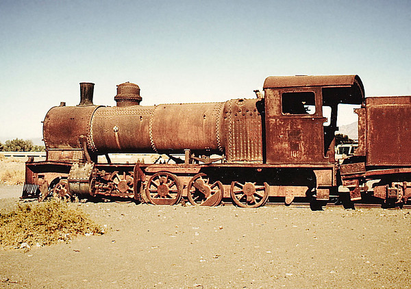 A severely-damaged engine and coal tender off its tracks at a station site near Al-Mu'azzam, south of Tabuk.