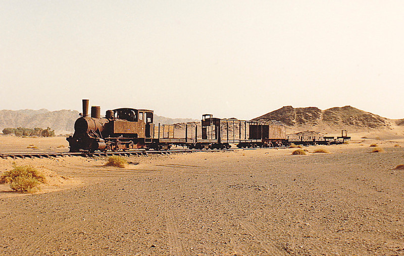Engine and rolling stock left intact on tracks at a station site somewhere between Mada'in Salih and Al-Ula, Saudi Arabia.