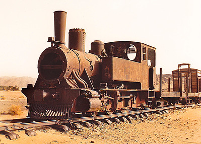 An abandoned WWI-vintage steam engine and rolling stock at a rail siding near one of the scores of fortified way-stations built by the Turks just prior to World War I.