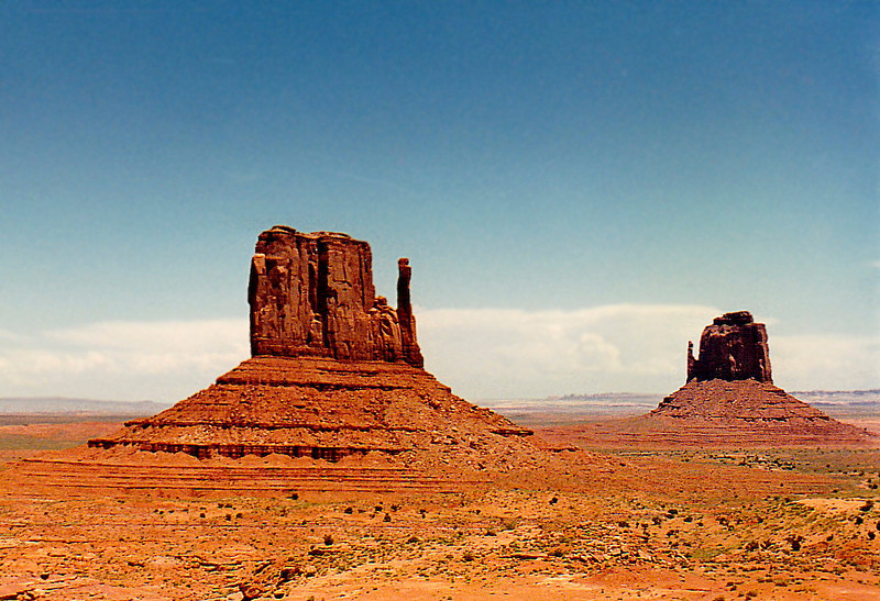 Erosional features in Monument Valley: The Mitten (foreground), the Four Corners region (Arizona, New Mexico, Colorado, & Utah) at Monument Valley.