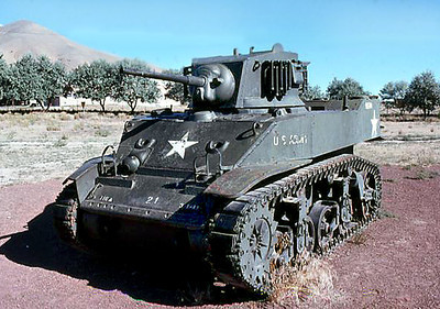 "Frontal view, WWII-vintage M5A1 ""Stuart"" Light Tank parked in what later became the  Nevada Veterans Memorial Park, located on the west side of Highway US95 about 1.4 miles north of the US40/US95 junction in Winnemucca, Nevada.  Armament: 1-M6 37mm main gun; 1-.50 cal machine gun; 2-M1919A4 .30 cal machine guns.  Winnemuca Stuart Tank website: http://www.waymarking.com/waymarks/WMDT4A_M5A1_Stuart_Light_Tank_Winnemucca_NV.  August 1976"