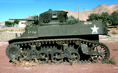 "WWII-vintage M5A1 ""Stuart"" Light Tank parked in what later became the  Nevada Veterans Memorial Park, located on the west side of Highway US95 about 1.4 miles north of the US40/US95 junction in Winnemucca, Nevada.  Armament: 1-M6 37mm main gun; 1-.50 cal machine gun; 2-M1919A4 .30 cal machine guns.  Winnemucca Stuart Tank website: http://www.waymarking.com/waymarks/WMDT4A_M5A1_Stuart_Light_Tank_Winnemucca_NV  August 1976"