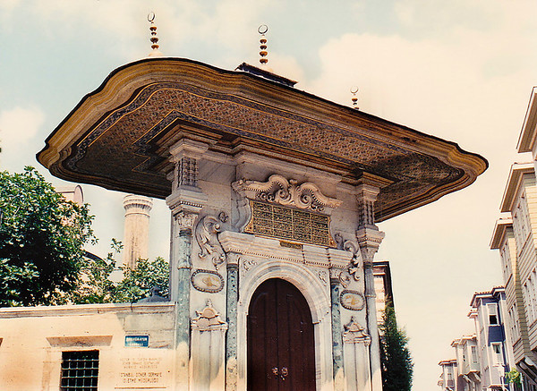 "An ornately sculpted outer-wall gate leading into the inner precincts of the Topkapi Palace. The palace was built by Sultan Mehmed II in 1478 and was used as the seat of government. The original name is Saray-I Cedid, which means ""the New Palace"" as it is the second palace built in Istanbul by the Ottomans after the conquest of Constantinople in 1453. With its four courtyards, today it is the second largest palace complex in the World covering an overall area of 700,000 square meters. With its four courtyards, today it is the second largest palace complex in the world covering an overall area of 700,000 square meters."