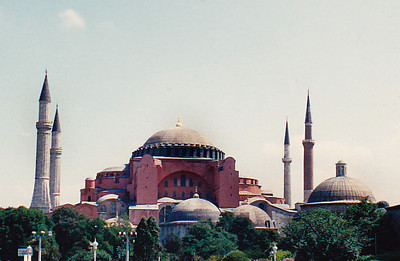 """Hagia Sophia, """"the Church of Holy Wisdom"""": From the date of its dedication in 360 until 1453, it served as an Eastern Orthodox cathedral and seat of the Patriarchate of Constantinople,[1] except between 1204 and 1261, when it was converted to a Roman Catholic cathedral under the Latin Empire. In 1453, Constantinople was conquered by the Ottoman Turks under Sultan Mehmed II, who subsequently ordered the building converted into a mosque.[9] The bells, altar, iconostasis, and sacrificial vessels were removed and many of the mosaics were plastered over. Islamic features – such as the mihrab, minbar, and four minarets – were added while in the possession of the Ottomans. It remained a mosque until 1931 when it was closed to the public for four years. It was re-opened in 1935 as a museum by the Republic of Turkey."""