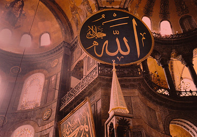 Interior of Hagia Sophia: The most famous restoration of the Aya Sofya was ordered by Sultan Abdülmecid and completed by eight hundred workers between 1847 and 1849, under the supervision of the Swiss-Italian architect brothers Gaspare and Giuseppe Fossati. The brothers consolidated the dome and vaults, straightened the columns, and revised the decoration of the exterior and the interior of the building. The mosaics in the upper gallery were cleaned. The old chandeliers were replaced by new pendant ones. New gigantic circular-framed disks or medallions (reportedly made of tanned camel hides; one can be seen in this photo) were hung on columns. They were inscribed with the names of Allah, the Prophet Muhammad, the first four caliphs Abu Bakr, Umar, Uthman and Ali, and the two grandchildren of Mohammed: Hassan and Hussain, by the calligrapher Kazasker Mustafa İzzed Effendi (1801–1877).