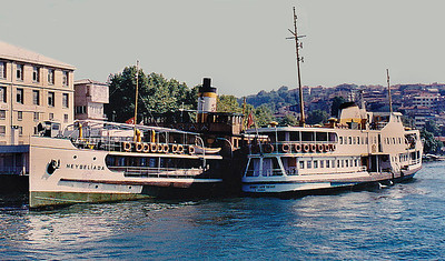 A pair of ferries (doubling as tour boats) tied up at a quayside anchorage near The Golden Horn, an embayment of the Bosporus that defines the northeastern limit of Istanbul. All of the Bosporus photos herein were shot from the upper deck of the boat on the left.