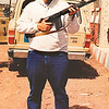 """Your intrepid photographer posing with a Browning automatic rifle (lovingly known as a """"BAR"""") loaned to me by a local inhabitant of a village where we stopped to get gas."""