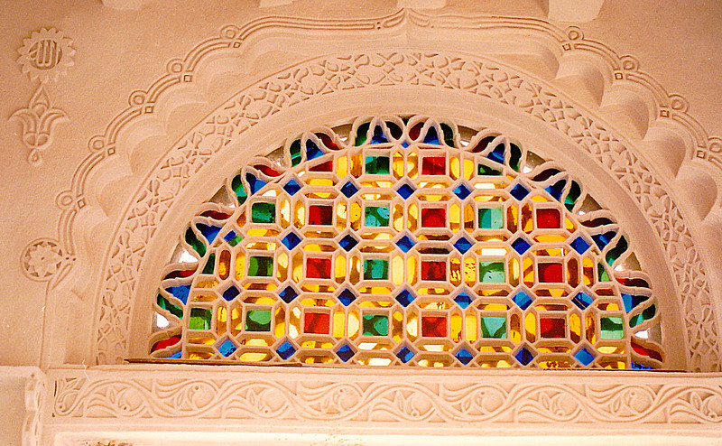Dar al-Hajar: This new stained-glass window and its ornately sculpted plaster of Paris frame were installed by the talented artisan glazier as I watched. He told me that this architectural art form has been practiced for a couple of centuries in the region that encompasses what is now southern Saudi Arabia and northern Yemen. I saw similar windows in homes near Najaran, Saudi Arabia.