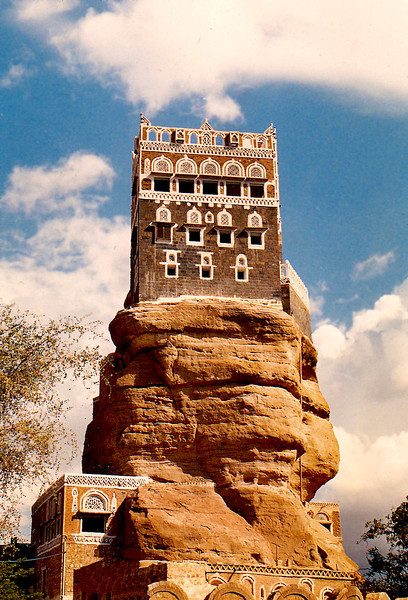 """Dar al-Hajar (locally known as """"the Rock Palace"""") is located on top of a rock outcrop (known as a """"hoodoo""""). It was built in the 1930s by Imam Yahya as a summer residence. At the time of my visit, it was open to the public while the interior rooms were being renovated and new stained-glass windows were being installed."""