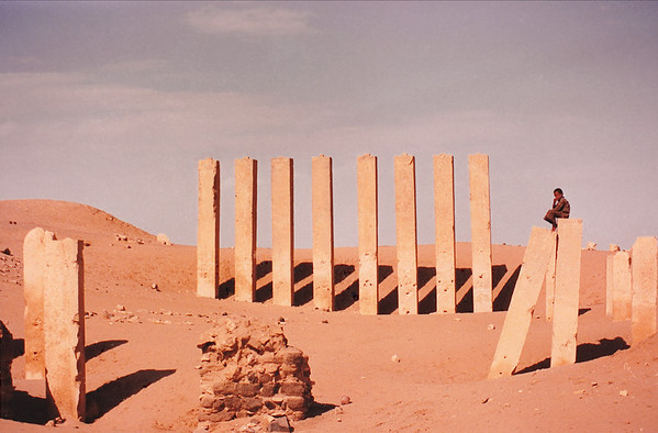 The ruins of the Bilqis Temple, also known as Al Haram Awwam, a Sabean-era structure near Marib, Yemen.   Many of the homes in this region have incorporated into their structures huge blocks of masonry and alabaster scavenged from the scores of Sabean ruins, many of which still display inscriptions in the arcane Sabean alphabet.