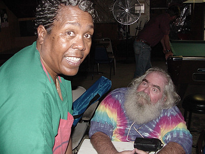 Cora Bullock (owner of Bullock's Soul Food Cafe - Helena Arkansas)  with Frank Lee in side her Cafe - King Biscuit Blues Festival - 2003.