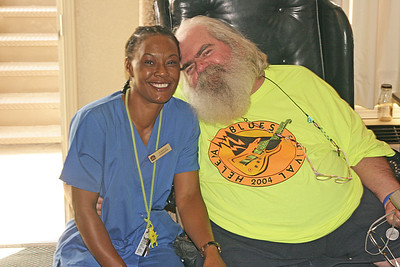 Frank got to talking to the woman who cleaned our room at the Best Western Motel in West Helena Arkansas.  Frank asked her if it was OK for me to take a picture of the two of them.  She said yes, so I did.  Beautiful smile!  You too, Frank.  King Biscuit Blues Festival - 2005.
