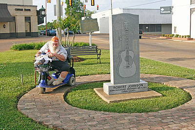 Frank negotiating the narrow walkway around this Robert Johnson memorial in Hazlehurst MS.