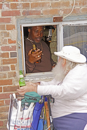 2009 King Biscuit Blues Festival - picking up a fifth of tequila at the liquor store's drive thru window in the alley in Helena AR