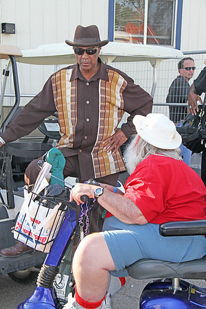 Frank Lee talks to a Blues musician, backstage at the 2010 King Biscuit Blues Festival.