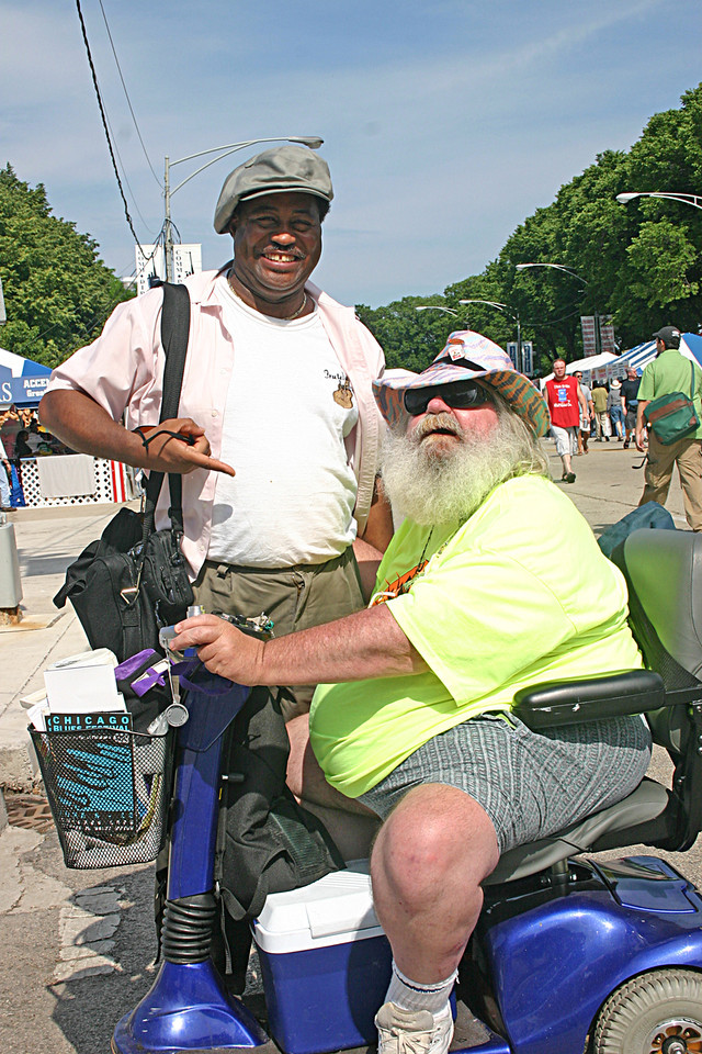 Frank just started talking to this guy as we were making our way from one stage to another at the 2005 Chicago Blues Festival.  I don't know what they were talking about.  Any way, he eventually asked me to take their picture.  I did.  This is it.