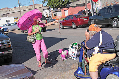 Frank Lee takes a picture of a lady in pink, with her pink poodle, at the 2008 King Biscuit Blues Festival - Helena, Arkansas.