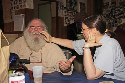 Mary Ann Kindel  administerng a healing to Frank Lee in Bullock's Soul Food Cafe, during the 2008 King Biscuit Blues Festival.