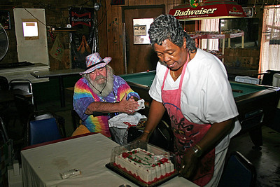 Cora Bullock, looks at her red velvet birthday cake, inside her place - Bullock's Cafe. Frank & I always brought Cora a birthday present when we were in Helena Arkansas.  This was during the 2004 King Biscuit Blues Festival
