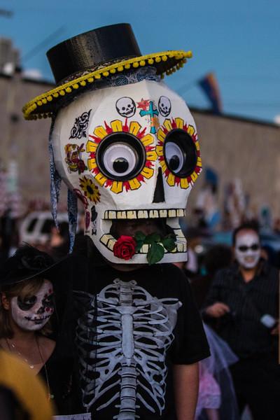 Man in paper mache sugar skull. 25th Annual All Souls Procession 2014, Tucson, Arizona USA