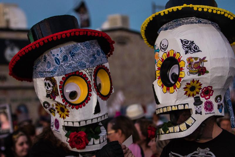 Two men in paper mache sugar skulls. 25th Annual All Souls Procession 2014, Tucson, Arizona USA