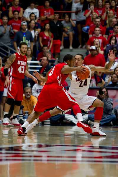 Brandon Lavender (24) guarding Utes Chris Hines (0). Arizona vs Utah basketball 11Feb2012