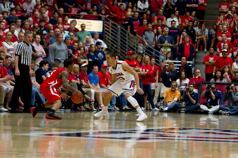 Nick Johnson (13) guarding Utes Kareem Storey (5). Arizona vs Utah basketball 11Feb2012