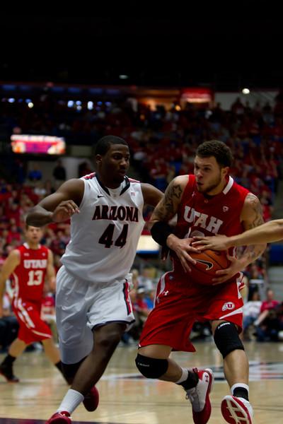 Salomon Hill (44) guards Utes Cedric Martin (43). Arizona vs Utah basketball 11Feb2012