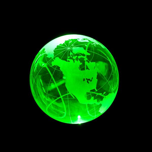 green laser illuminating a glass globe